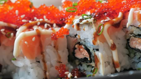 ノリ : Close-up dolly slide shot of traditional delicious sushi rolls. Traditional Japanese cuisine. 動画素材