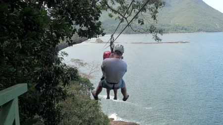 mounted : Happy couple Riding A Zip Line , Tourists On Zip Line In