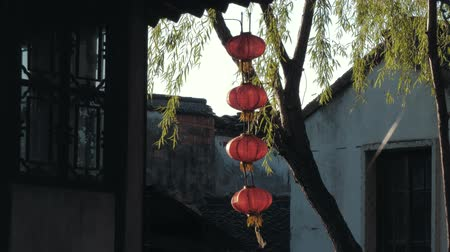 chinese lantaarn : Slow motion view of chinese old lanterns swinging in the wind in old Water Town Luzhi. Traditional Chinese decoration. Life and travel in China.