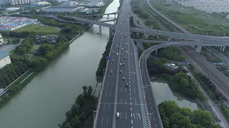 crossing road : Aerial drone view of highway multi-level junction road with moving cars at sunset. Cars are moving on a multi-level road junction The concept of the urban. Suzhou city, China.