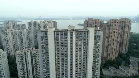 비싼 : Aerial drone shot over residential apartment buildings on sunset. Flight over community apartment complex with modern buildings and lake on the background. 무비클립