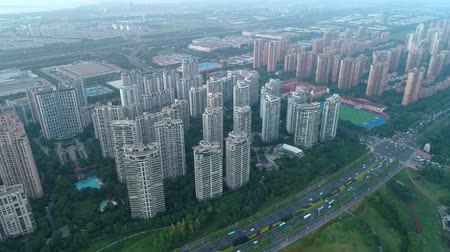 blocks of flats : Aerial drone shot over residential apartment buildings on sunset. Aerial shot over community apartment complex in China.