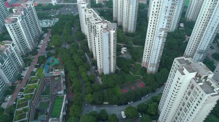 blocks of flats : Aerial vertical shot over residential apartment buildings on sunset. Aerial shot over community apartment complex in China.