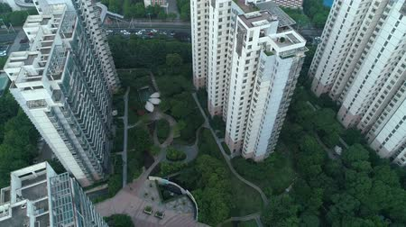 establishing shot : Aerial vertical shot over residential apartment buildings on sunset. Aerial shot over community apartment complex in China.