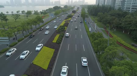 samochód : Aerial view of cars running on the city road at sunset, China.