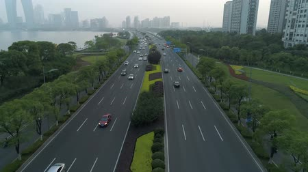 manzaraları : Aerial view of cars running on the city road at sunset, China.