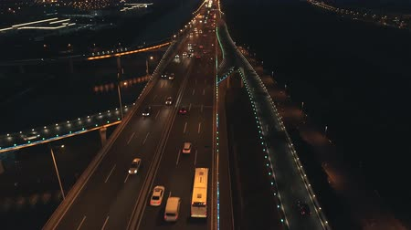 manzaraları : Aerial top view of highway interchange at night. Aerial top view of road junction from above, automobile traffic and jam of many cars, useful for engineering, industrial, transportation concept Stok Video