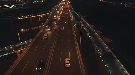orta hava : Aerial top view of highway interchange at night. Aerial top view of road junction from above, automobile traffic and jam of many cars, useful for engineering, industrial, transportation concept Stok Video