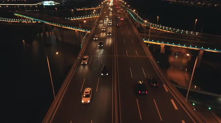 полезный : Aerial top view of highway interchange at night. Aerial top view of road junction from above, automobile traffic and jam of many cars, useful for engineering, industrial, transportation concept Стоковые видеозаписи
