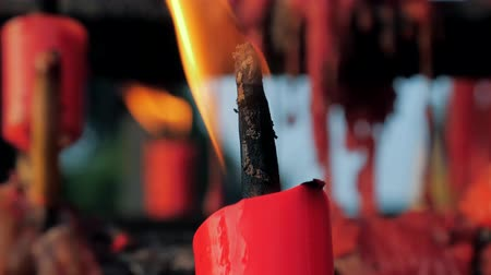 лунный : Close-up shot of a candles burning in a Buddhist temple., China.