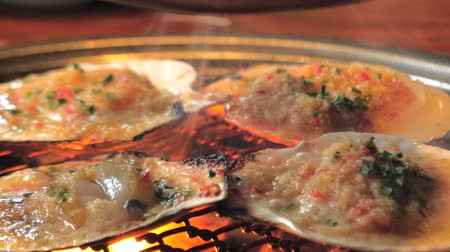 scallop : Big fresh scallop shell seafood grill on metal net with charcoal, barbecue in korean restaurant. Barbecue cooking style