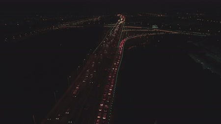 moskova : Aerial top view of highway interchange at night. Aerial top view of road junction from above, automobile traffic and jam of many cars, useful for engineering, industrial, transportation concept Stok Video