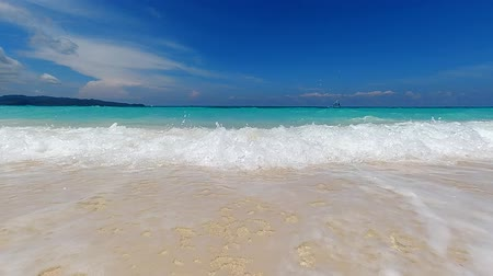 boracay : Turquoise ocean waves roll in on the sandy beach on tropical island. Ocean seascape scenic. Amazing summer travel vacation beach background. Stock Footage
