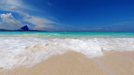 white sand : Turquoise ocean waves roll in on the sandy beach on tropical island. Ocean seascape scenic. Amazing summer travel vacation beach background. Boracay, Philippines.