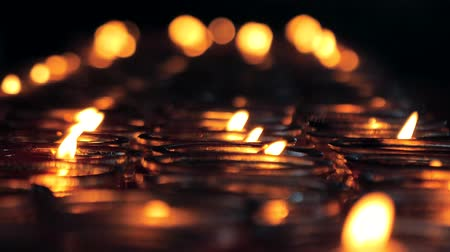 ладан : Close-up shot of a candles burning in a Buddhist temple., China.