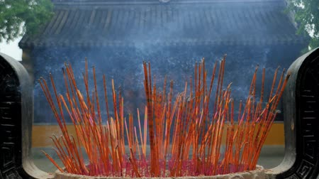 babona : Incense sticks are burning slowly in the burner of a chinese temple. Stock mozgókép
