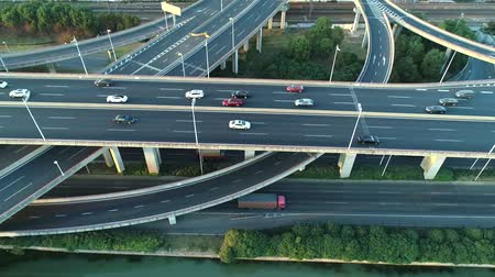 fast pass : Aerial view of road junction with moving cars. Road interchange or highway intersection with busy urban traffic speeding on the road.