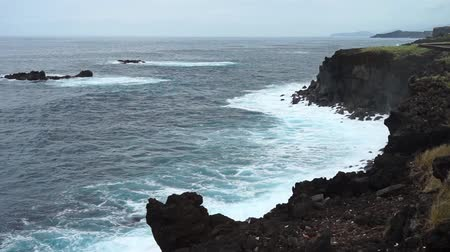 sao miguel : Lookout at cliffs and coastline in raining weather with cloudy sky, Sao Miguel Island, Azores