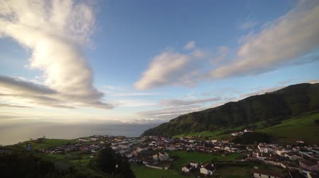 sao miguel : Beautiful sunrise coast view to a small greek town village with blue seain Sao Miguel