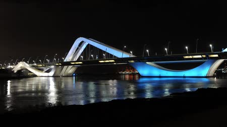 changing lights : Time lapse of the Sheikh Zayed bridge in Abu Dhabi. Its curved design arches evoke undulating sand dunes of the desert. It also has a colorful subtle changing lighting design.