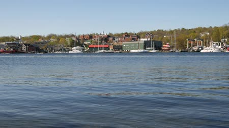 belfast : Panning video of the Belfast, Maine waterfront in the early springtime with water rippling in the foreground.