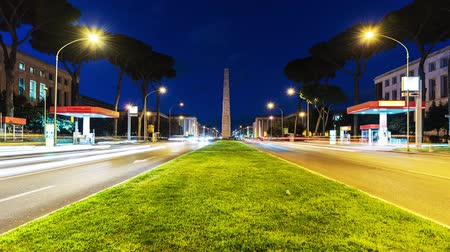 Time Lapse of traffic at night in the EUR district with view over Marconi obelisk. Rome, Italy