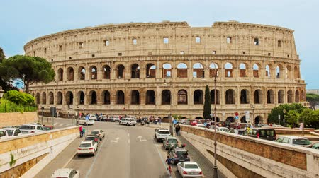 Time lapse with pan effect and aerial view over the Flavian Amphitheatre, aka Colosseum in Rome, Italy