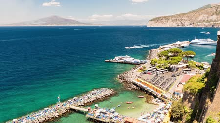 Timelapse with aerial view of Mount Vesuvius and the town of Sorrento, Bay of Naples, Italy. Panning shot