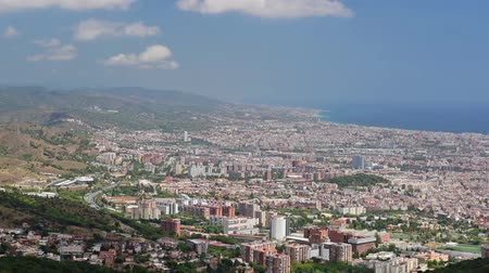 Scenic aerial view from Tibidabo mountain over the city of Barcelona, ??Catalonia, Spain. Panning shot