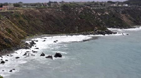 Timelapse with waves crashing on a beach in Milazzo, Sicily, Italy. Seemless video loop
