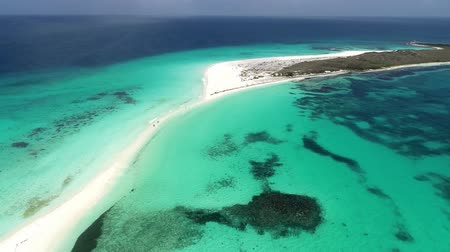 Los Roques, Caribbean sea. Fantastic landscape. Aerial view of paradise island with blue water. Great caribbean beach scene. Vacation on deserteds beaches. Travel destination. Tropical Travel. Stock mozgókép