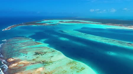 deserted : Los Roques, Caribbean sea. Fantastic landscape. Aerial view of paradise island with blue water. Great caribbean beach scene. Vacation on deserteds beaches. Travel destination. Tropical Travel. Stock Footage