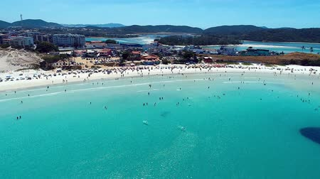sand paper : Cabo Frio, Rio de Janeiro, Brazil: Aerial view of a blue sea and clear weather. Fortes Beach. Fantastic landscape. Great beach scene. Vacation travel. Travel destination. Caribbean sea. Tropical travel. Panoramic view. Stock Footage