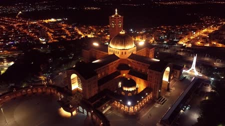 fame : Aerial view of the Shrine of Our Lady of Aparecida, Aparecida, S? O Paulo, Brazil. Patroness of Brazil. Church, temple, religion, faith. Night flight. Beautiful landscape. Great church view!