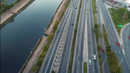 yedi : Aerial view of traffic on freeway. Tietes River scenery. Cars, buses and trucks on the road. Freeway, traffic, speed.
