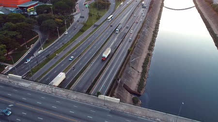 self driving : Aerial view of traffic on freeway. Tietes River scenery. Cars, buses and trucks on the road. Freeway, traffic, speed.