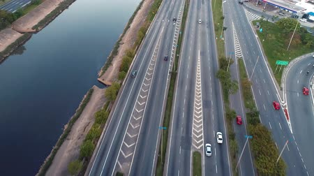Aerial view of traffic on freeway. Tietes River scenery. Cars, buses and trucks on the road. Freeway, traffic, speed.