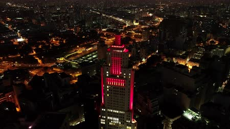 Aerial view of Santanders Lighthouse, the tourism point exactly in the center of Sao Paulo, Brazil. Great landscape. Flying during night. Sao Paulos downtown. Stock mozgókép