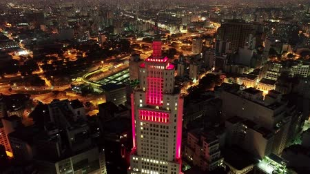Aerial view of Santanders Lighthouse, ancient Banespas bank. Tourisms point exactly in the center of Sao Paulo, Brazil. Great night cityscape. Sao Paulos downtown scenery.