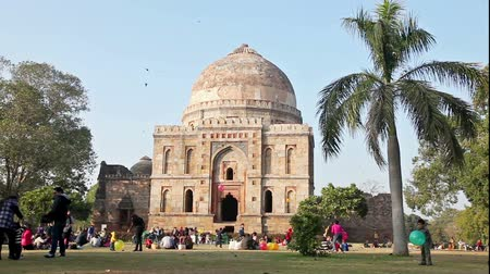 bara : New Delhi, India - January 20: Bara Gumbad  tomb in Lodi Garden, New Delhi on January 20, 2013. Indian families come to Lodi Gardens at weekend to have picnics and play with their children.