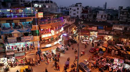 hurry : New Delhi, INDIA -  JANUARY 21, 2013: Night view of Main bazar Pahar Ganj street in New Delhi. People, cars, motorbikes and auto rickshaws on the street near by shops at night Stock Footage