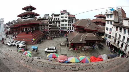 DURBAR SQUARE, KATHMANDU, NEPAL - APRIL 4, 2014: View from the top of Nepali pagoda to Durbar Square market at rainy day