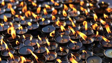 patan : Butter lamps with flames in the temple of Bodnath Stupa in Kathmande, Nepal