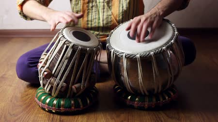 Man playing on traditional Indian tabla drums close up Wideo