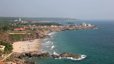 Kovalam tropical beach with resort and mosque in lagoon at Kerala, India. View from the top