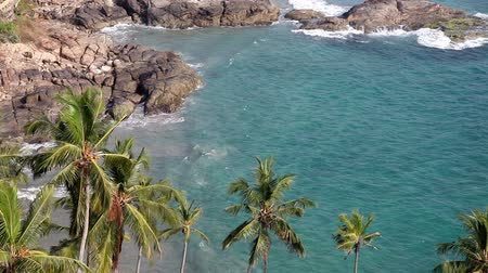 Tropical lagoon with waves on the rocky beach. View from the top