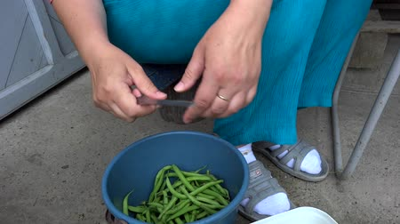 person cutting green beans