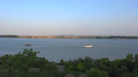 two ships passing in the Danube River Stock Footage