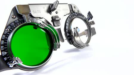 Spectacles used for eyesight tests with various lenses and green filter lens Stock mozgókép
