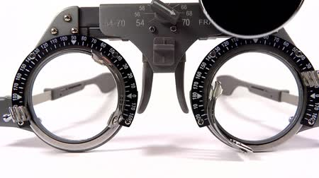 sighted : Spectacles used for eyesight tests with various lenses and occlusion on white background
